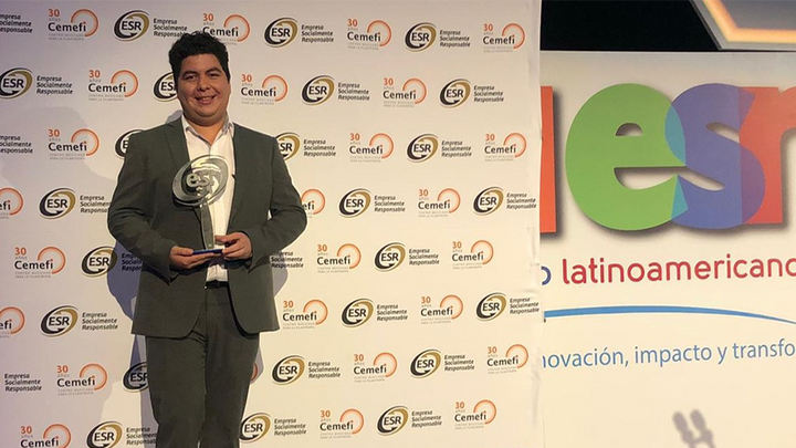 man holding an award