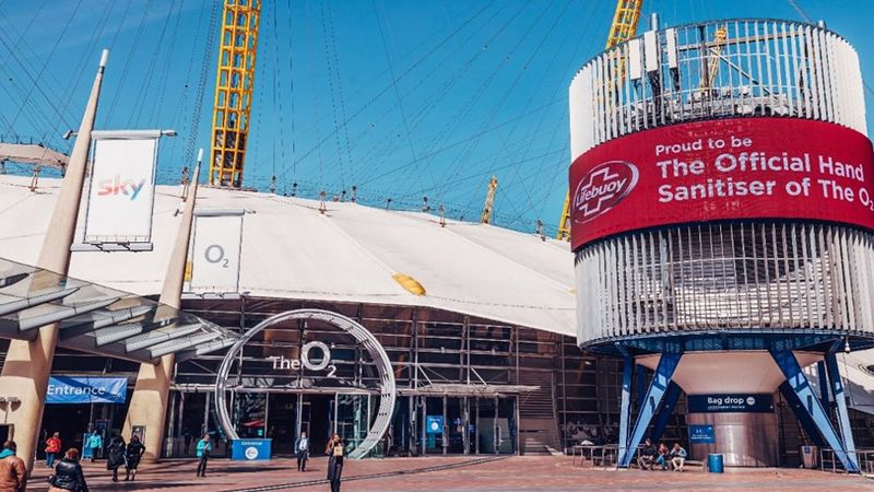 An image of the O2 arena with a digital display announcing Lifebuoy as the official hand sanitiser of the O2.