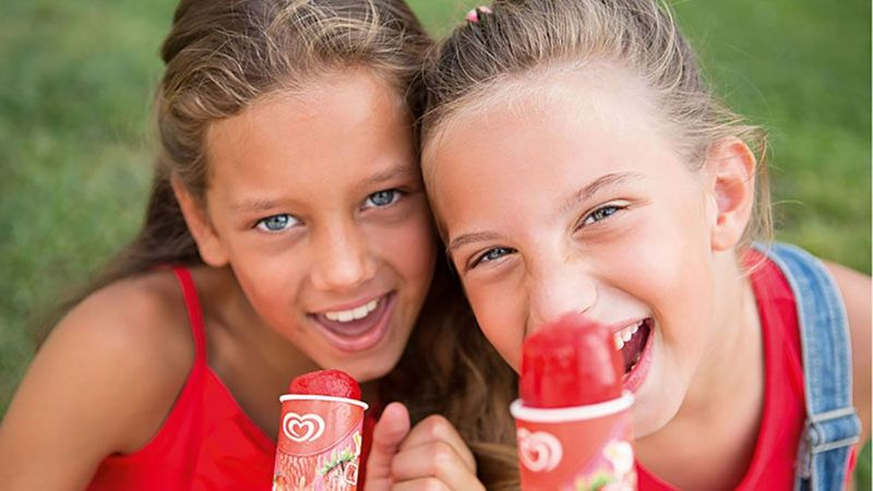 two girls holding ice-cream