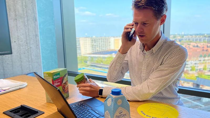 A man sitting at a computer inputting data
