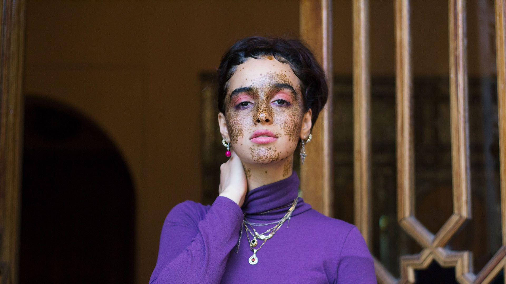 lady wearing a purple jumper