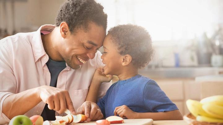 Father and son eating