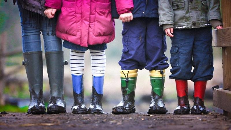 Kids in gumboots in rain