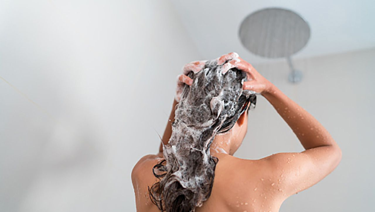 A person washing their hair