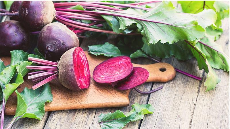 An image of a beet on a chopping board