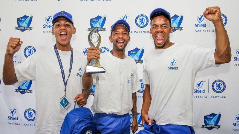 Shield winners holding the award