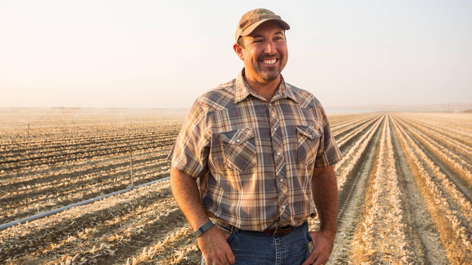 a smallholder farmer smiling