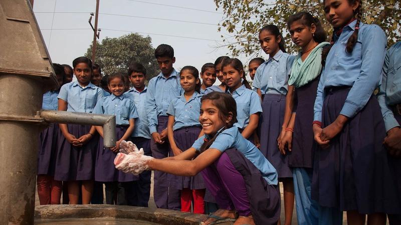 Schoolgirl washing hands