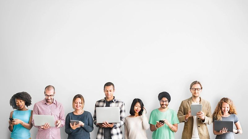 People in a row holding their devices