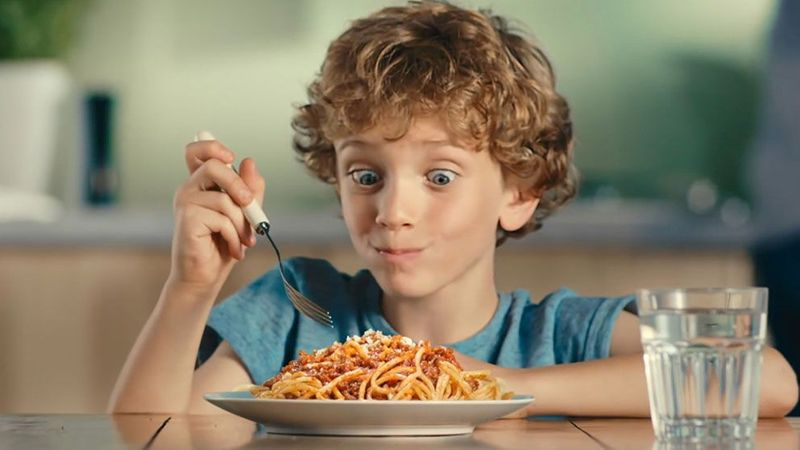 A boy tucks into a plate of food