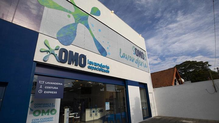 The exterior of an OMO branded laundromat in Brazil.