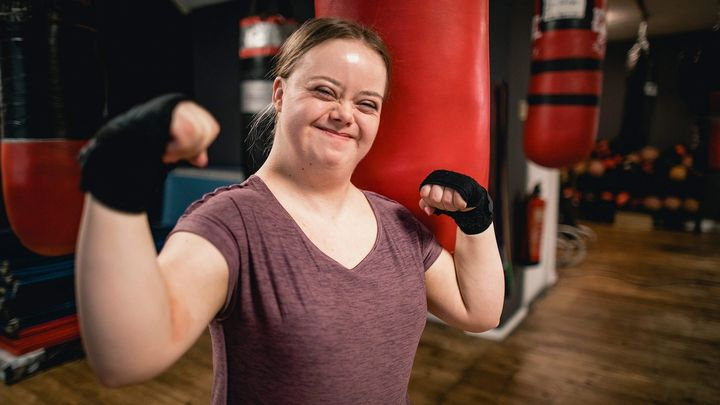 A girl in the gym with her hands wrapped