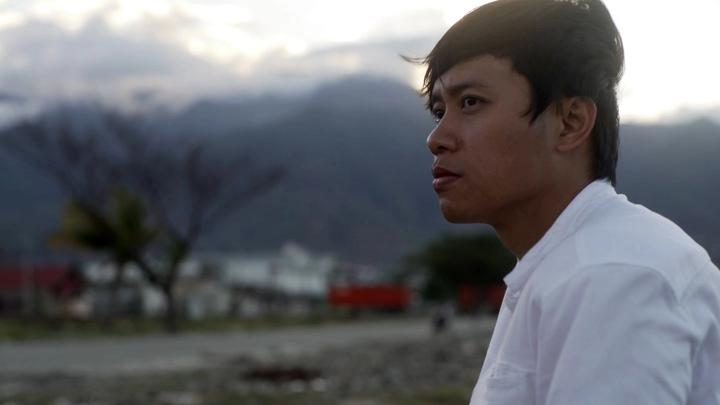 Winarto-Anggun Wicaksono looking thoughtful onto the damage caused by the earthquake in Palu, Indonesia