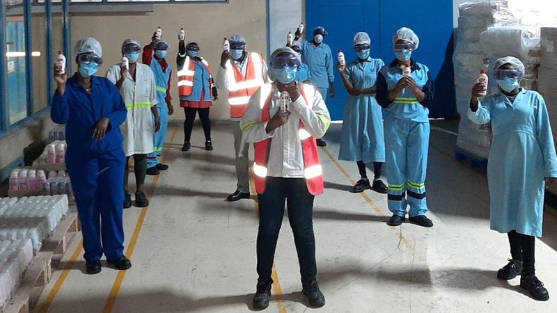 Unilever employees holding hand sanitizer in Africa