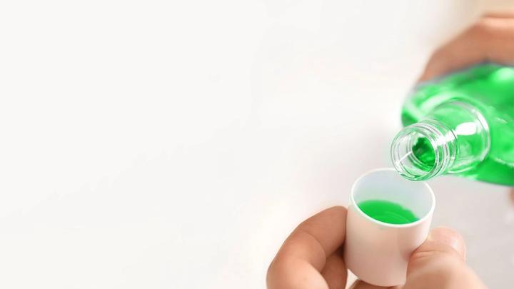 A photo of mouthwash in a glass