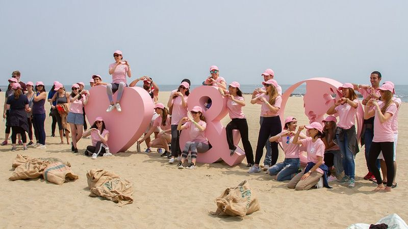 Members of the Love Beauty and Planet team dressed in pink.