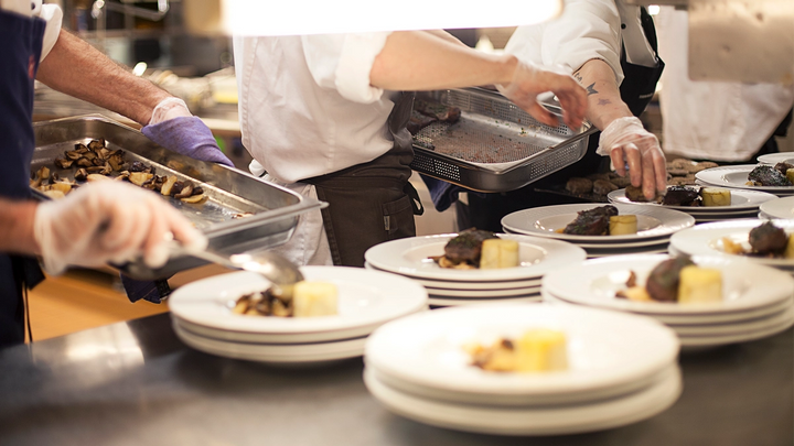 Plates of food being prepared in a kitchen
