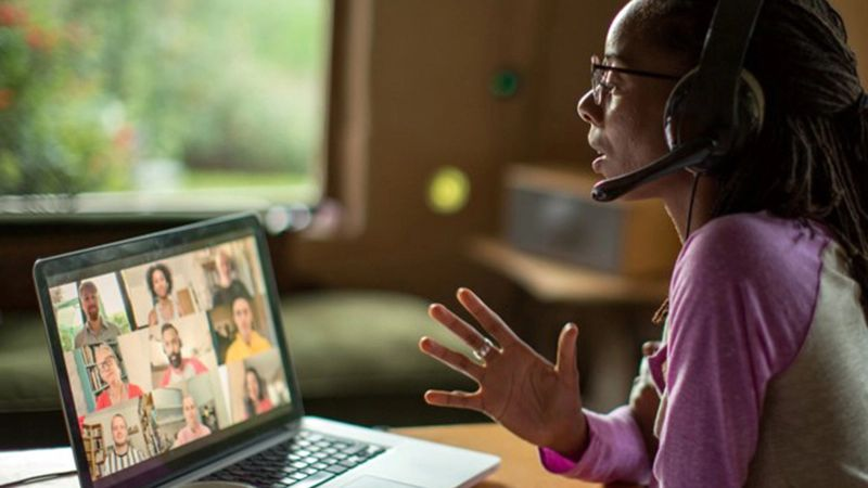 Woman speaking on video call whilst working from home