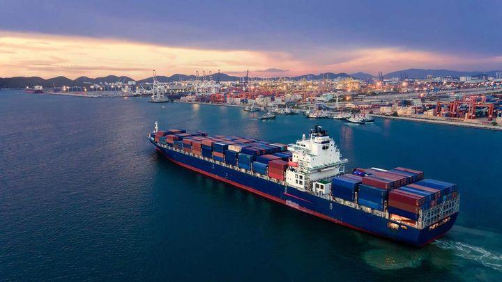 A cargo ship passing near a port