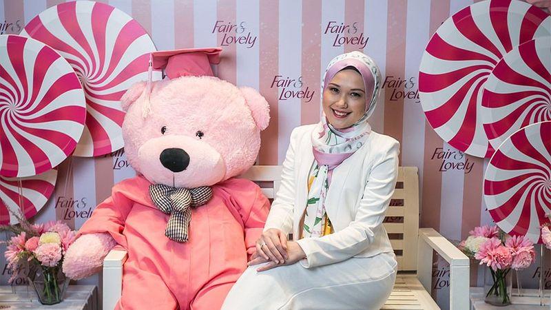Malaysia fair and lovely woman and bear