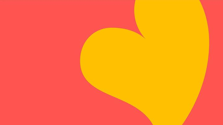 Yellow heart on a pink background