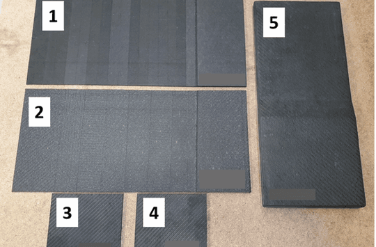 CFRP ply drop panels with embedded defects