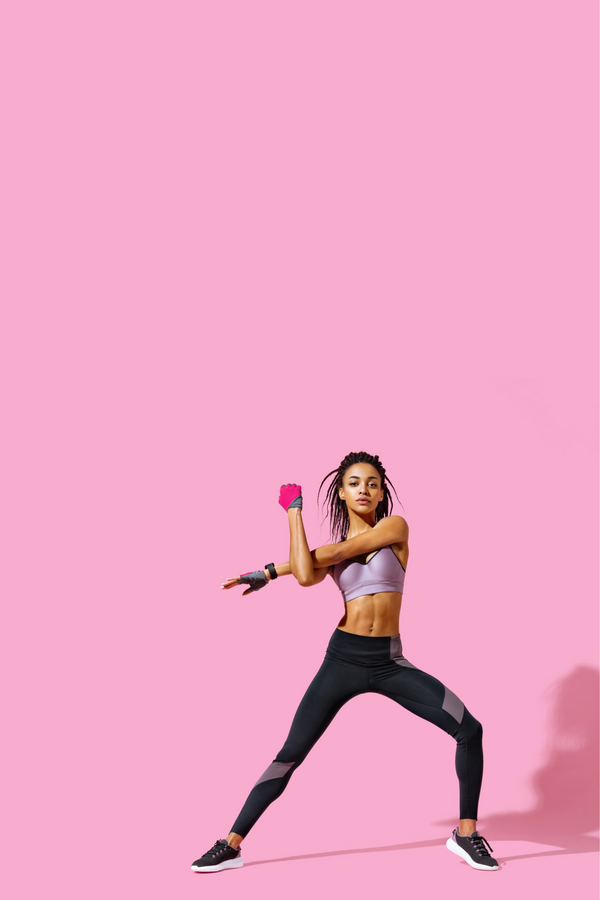 woman stretching in fitness apparel