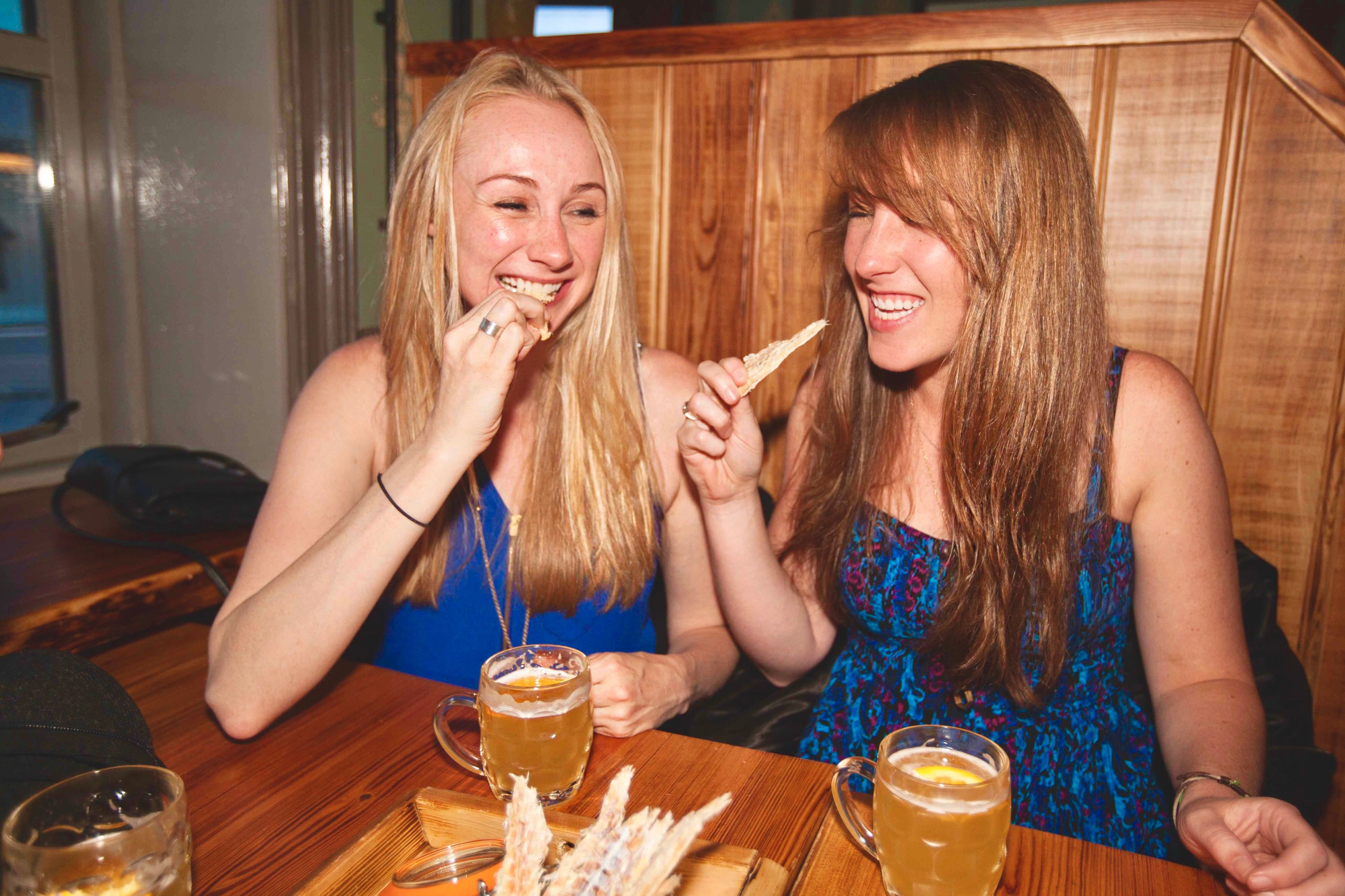 two guests enjoying dried cod and icelandic beer
