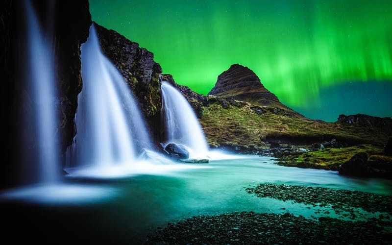 Aurora borealis over kirkjufell mountain