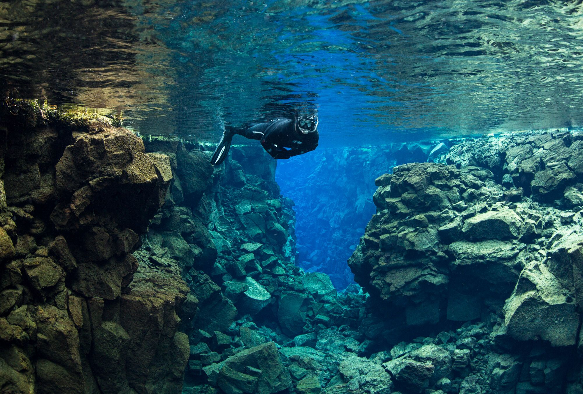 snorkler exploring the tectonic plates in Iceland