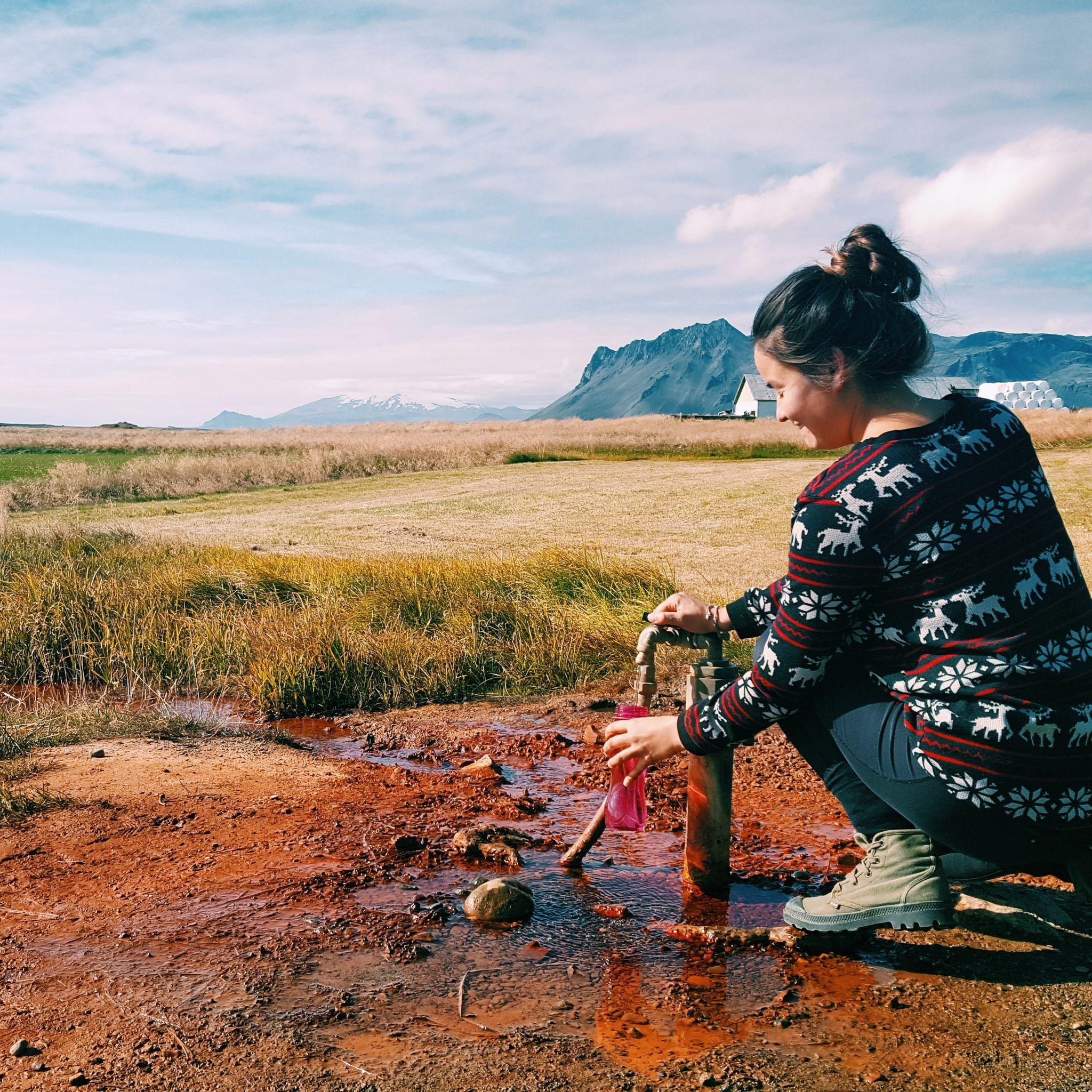 April filling up her water bottle by Ölkelda