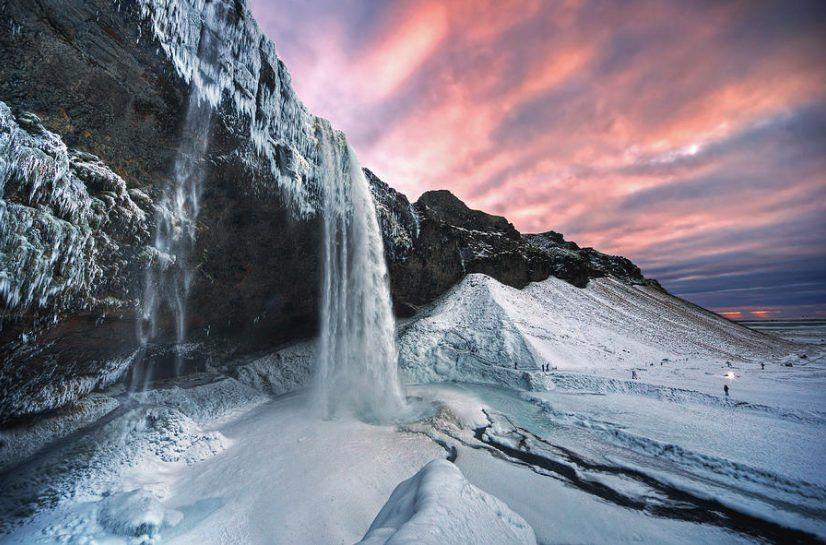 frozen seljalandsfoss waterfall during December