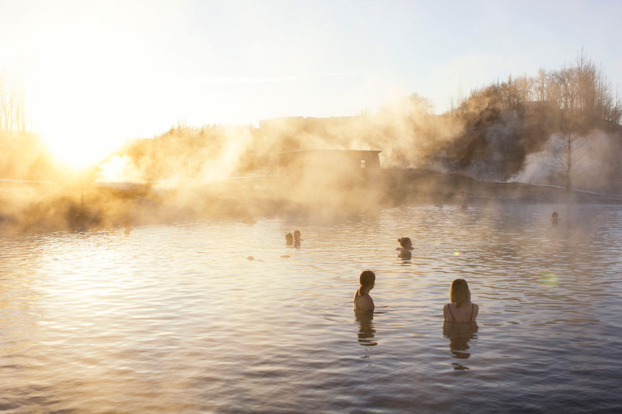 Travelers enjoying Secret lagoon natural hot spring