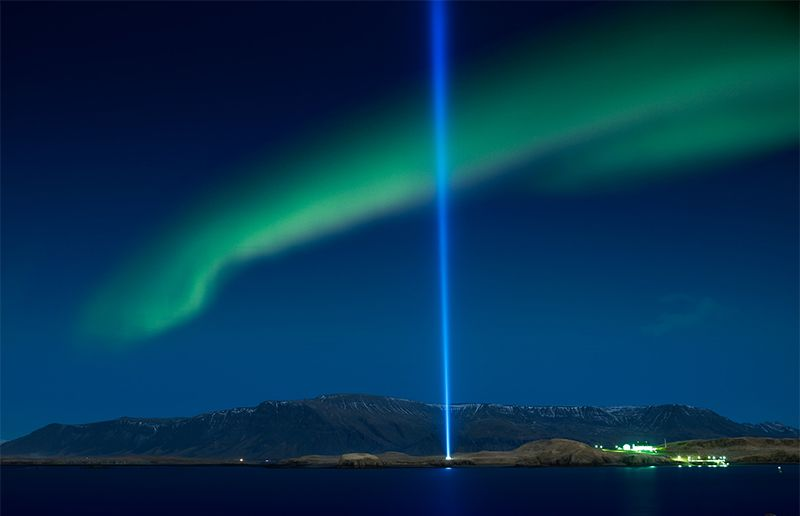 northern lights over the imagine peace tower