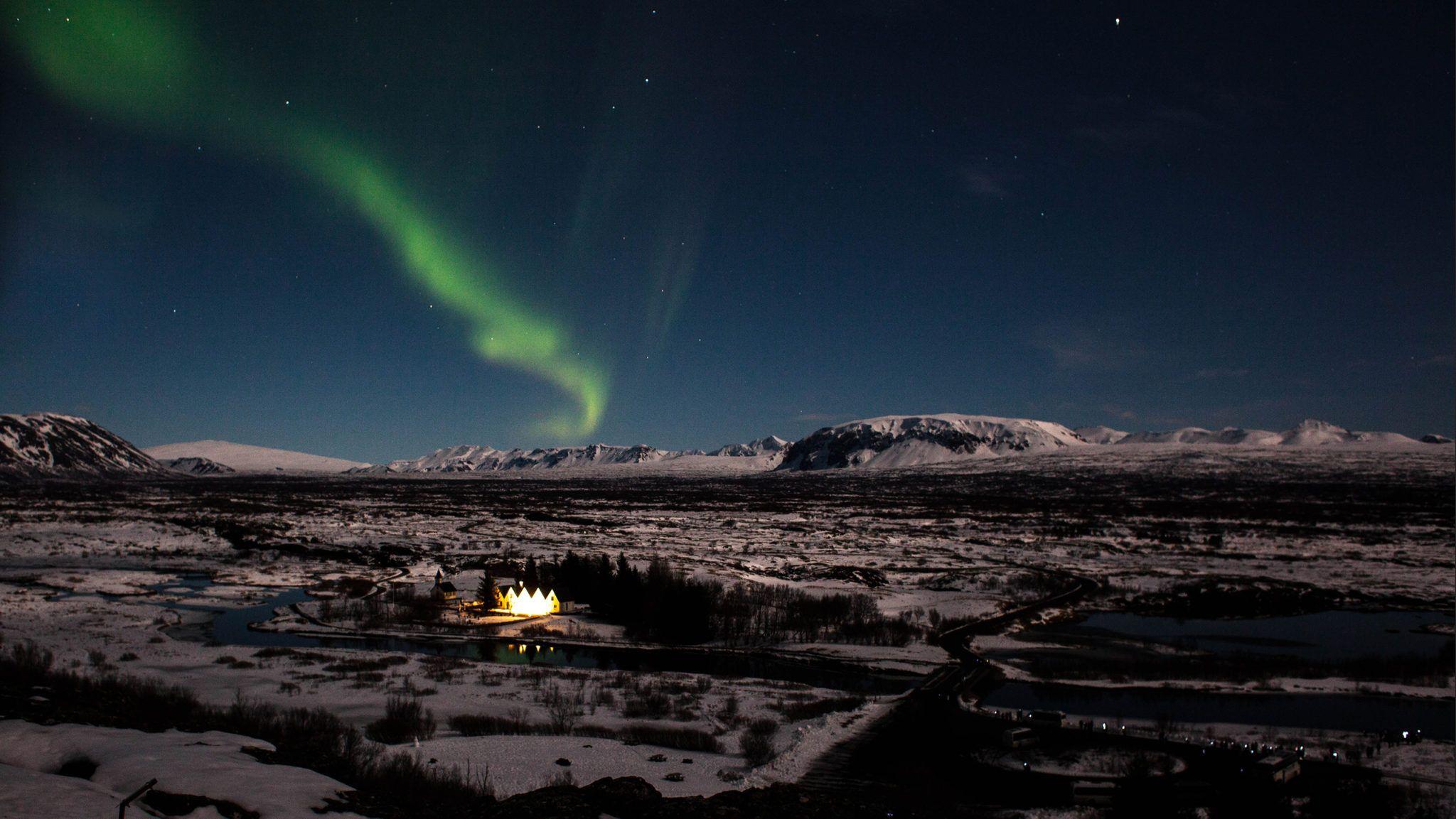 Aurora borealis over Þingvellir National Park during winter in Iceland