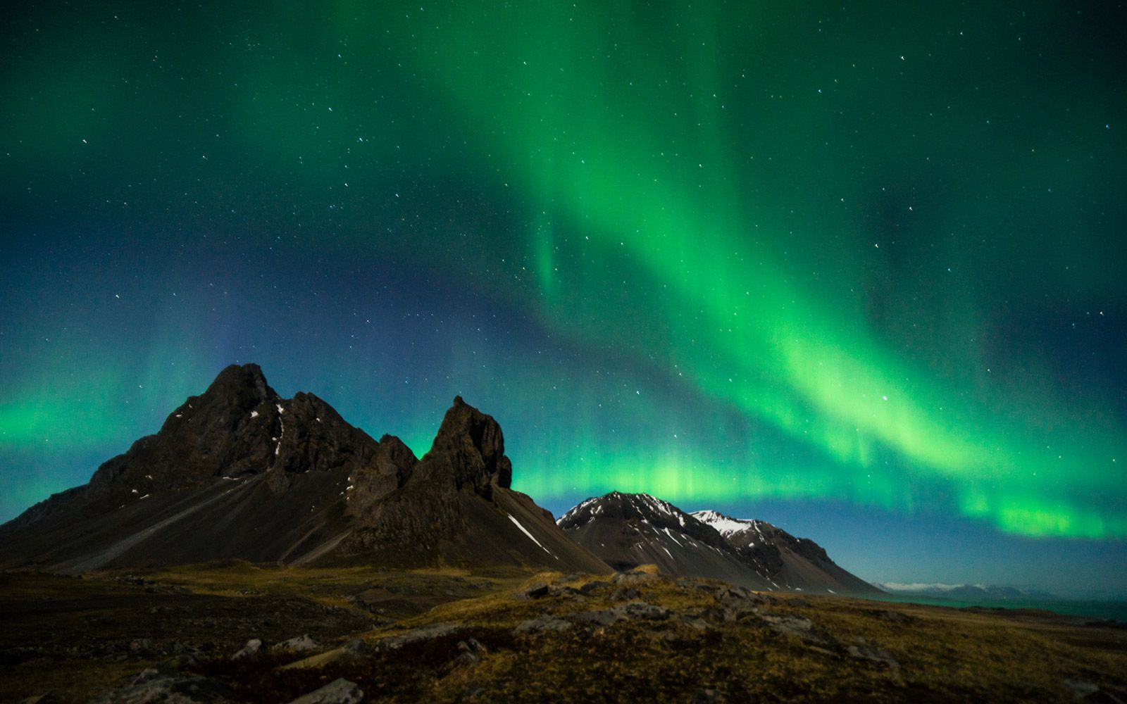 northern lights and mountains in Iceland