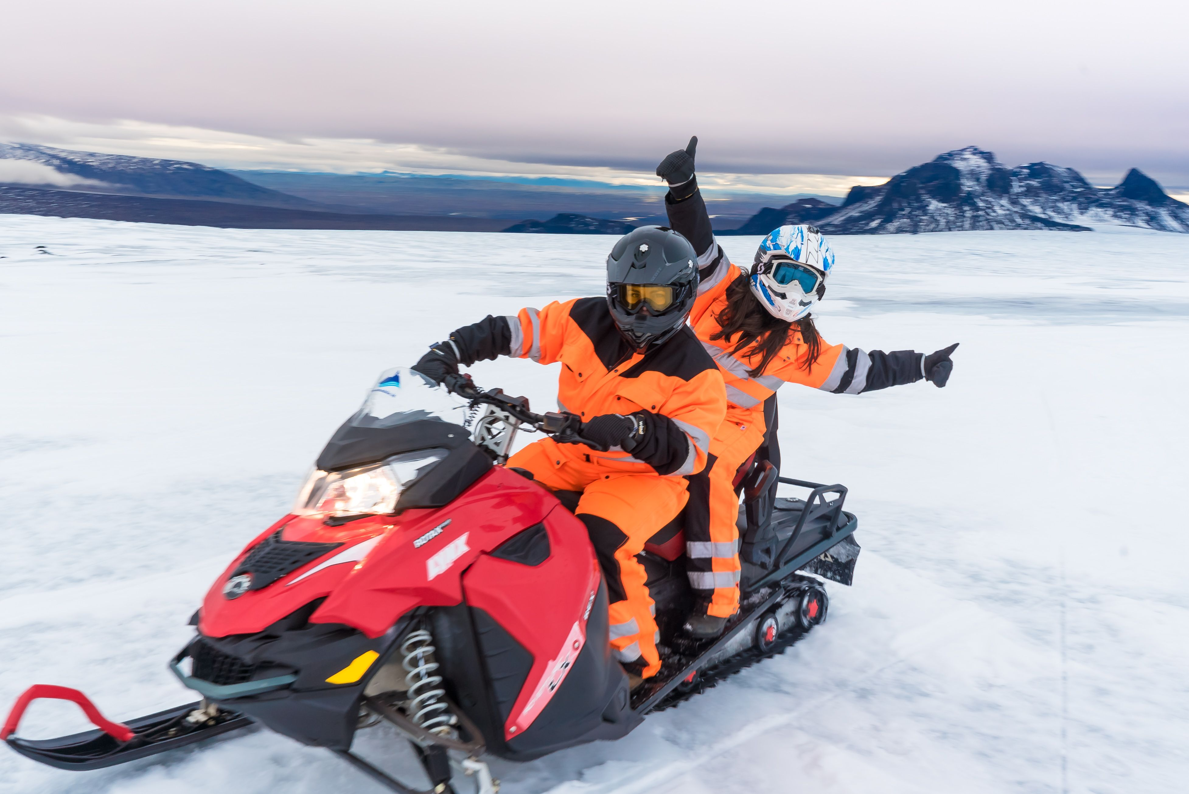 Guests riding a snowmobile on langjökull glacier
