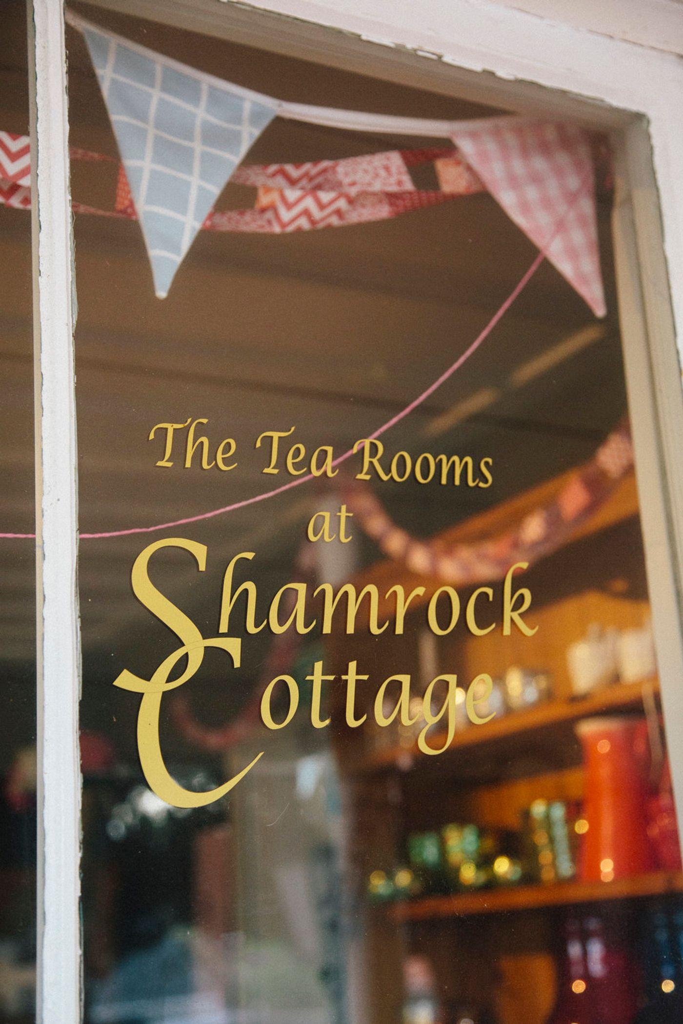 Shamrock cottage vinyl graphic on window