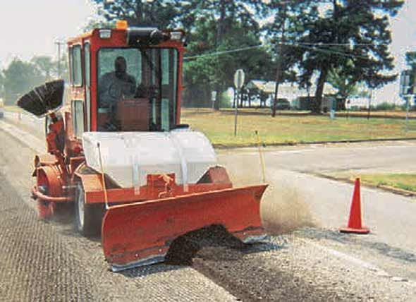 Broce-MK1-sweeping-and-loading-road-construction