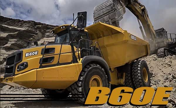 Bell B60E on a job site being loaded by an excavator