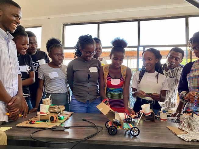 Students in Malawi presenting their invention