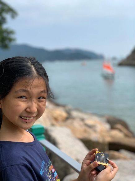 girl with micro:bit