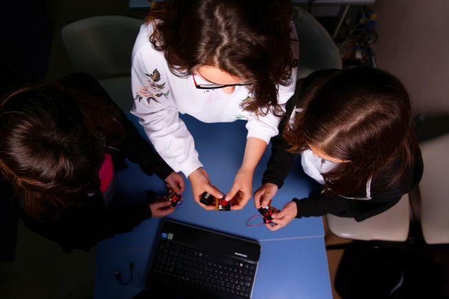 three girls working with micro:bit