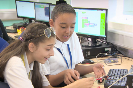 two girls working with micro:bit