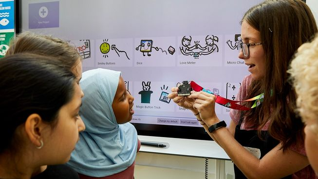 teacher showing micro:bit to pupils