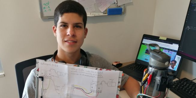 Sebastian with his design for the smart water bottle.