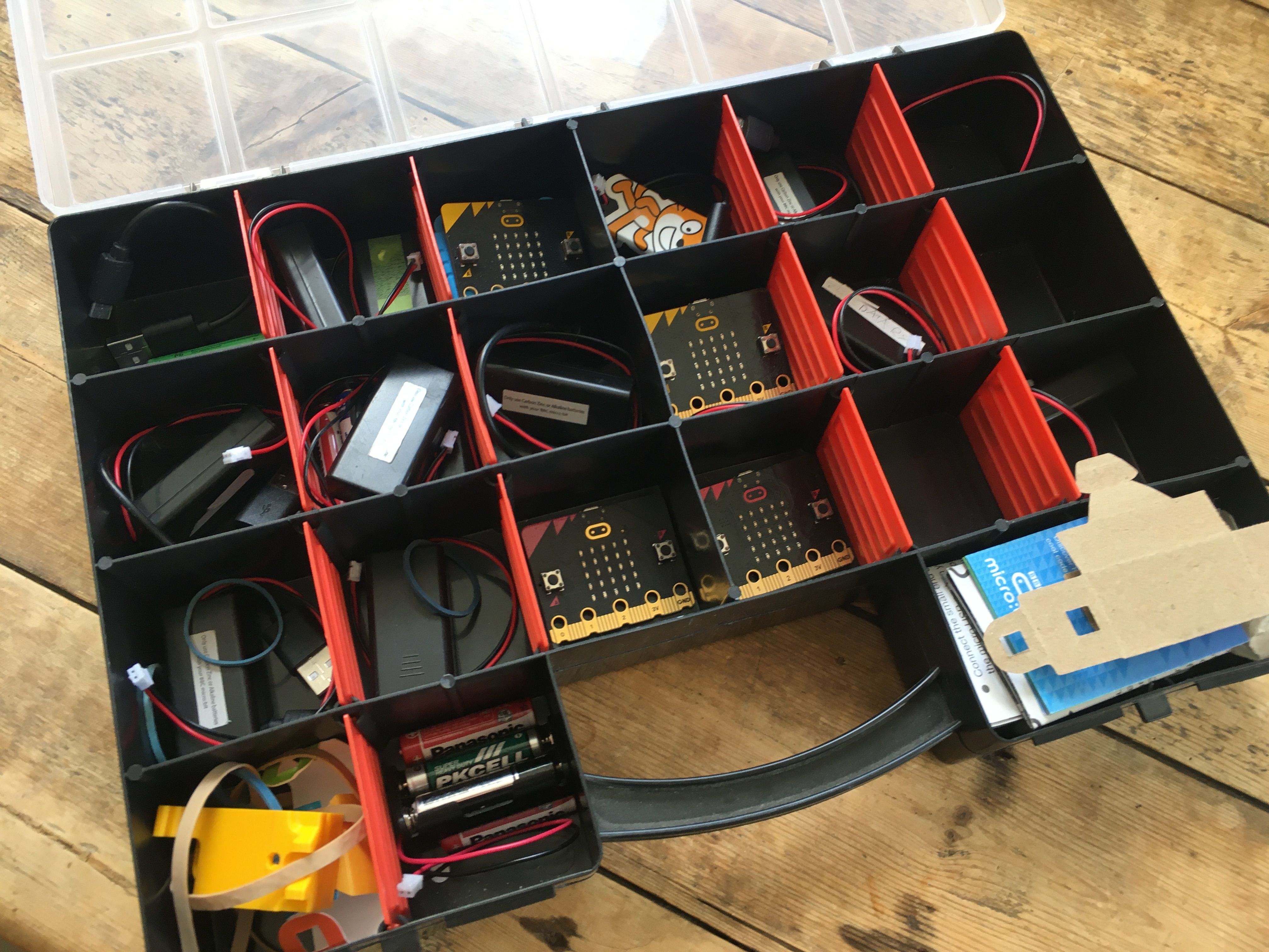 micro:bits stored in inexpensive craft tray