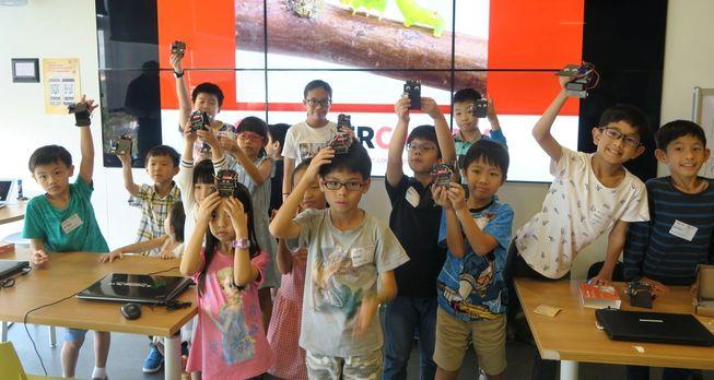 Children in Singapore holding micro:bits