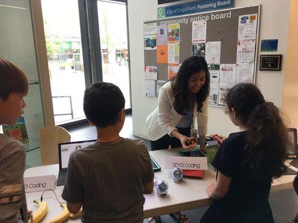 A teacher demonstrating micro:bit to pupils