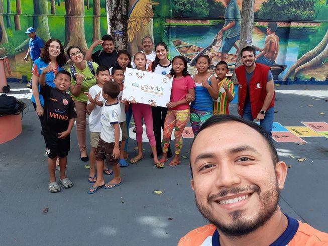 a group of Brazilian children with their teacher